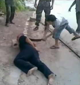 child beheading prisoner