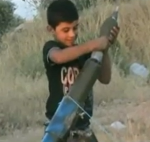 child firing mortar syria